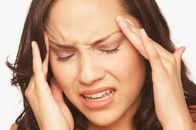 Close up of lady with headache